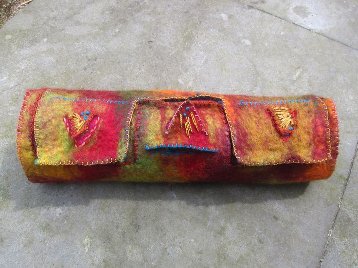 Layers in a felted pounch by Marjo Lelie