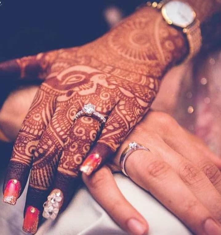 35 Striking Engagement Rings We Spotted On Real Brides Indian Wedding Photography Poses Indian Wedding Couple Photography Engagement Photography Poses