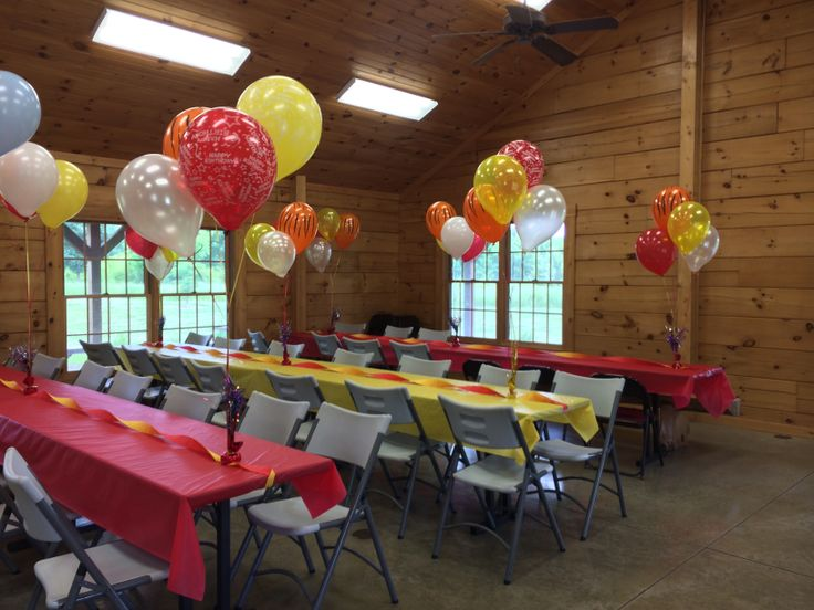 Tables and balloons in yellow and red for Daniel Tiger Birthday