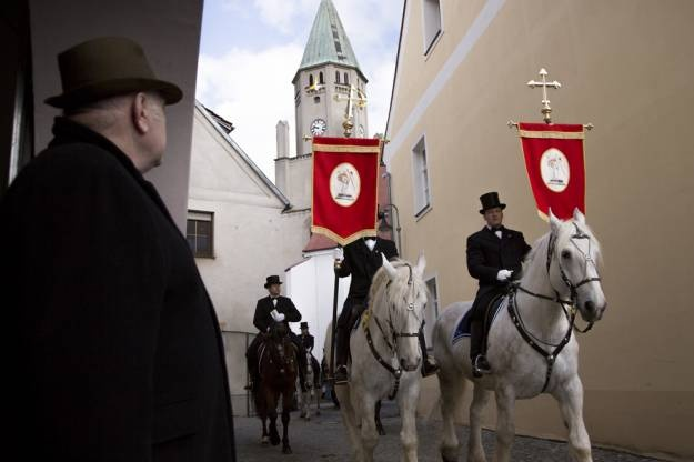 Riders sing as they parade on April 08, 2012 in Wittichenau, Germany. Sorbians, a Slavic minority in eastern Germany, celebrate Easter with processions of mounted riders dressed in 19th-century outfits who travel from village to village to sing and announce the resurrection of Jesus Christ. (Carsten Koall/Getty Images)