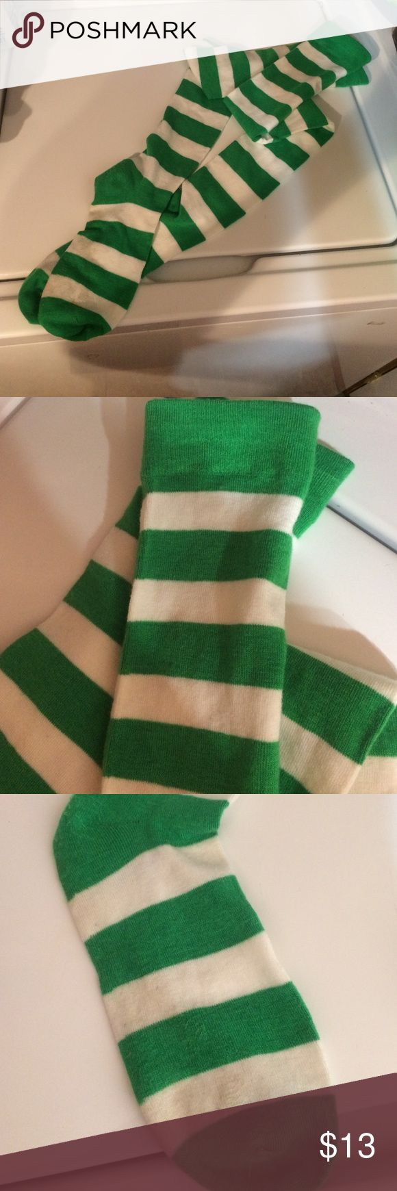 Green & white stripe Knee High Socks Wore once as my daughter was Luigi for Halloween 👻 perfect condition except for on the foot area no holes just off white on foot area. Paid $25 for them in sock store in the mall Accessories Hosiery & Socks