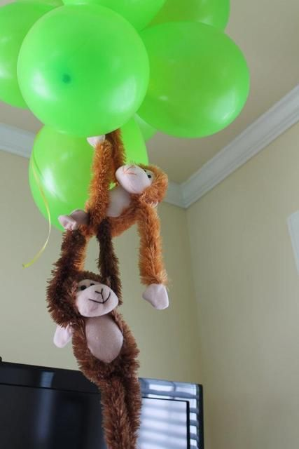 Balloons & Hanging Monkeys  Perhaps this could be welcoming statement outside!