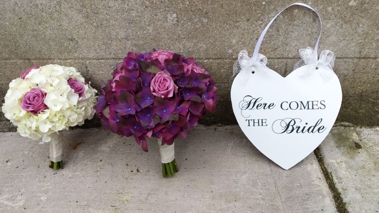 Bride and bridesmaid bouquets and these gorgeous plaques available from J P Flowers