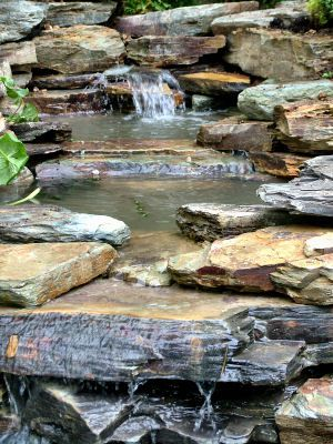 Slate Water Feature - love love love! Use THIS up near house, instead of the prefab concrete ones - to take run-off towards the stream!