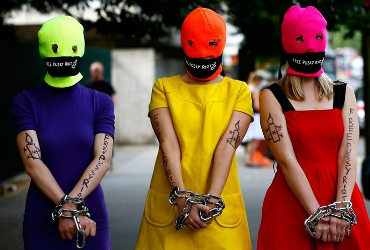 Three supporters of Russian female punk band Pussy Riot deliver a petition at the Russian embassy in London.