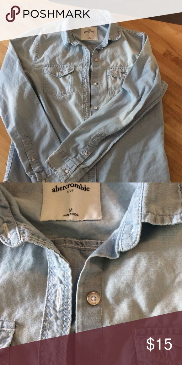 Abercrombie girls szM long sleeve chambray shirt Classic long-sleeved chambray shirt with buttons and front pockets with logo.  Gently used - worn about 4 times. Design of shirt was that color was uneven to look worn. abercrombie kids Shirts & Tops