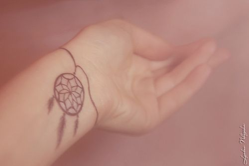 dream catcher tattoo. not saying i would get this, but i like it:)