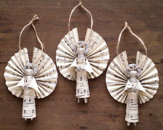 Clothespin Angels - Handmade Ornaments made with Vintage Sheet Music - Set of 3. $27.50, via Etsy.