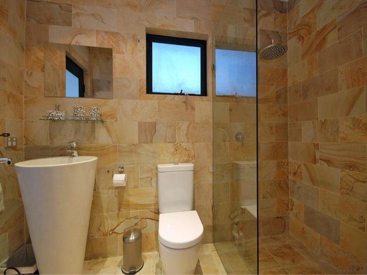 Modern touches and frameless glass in a bathroom design for Australian small bathroom design