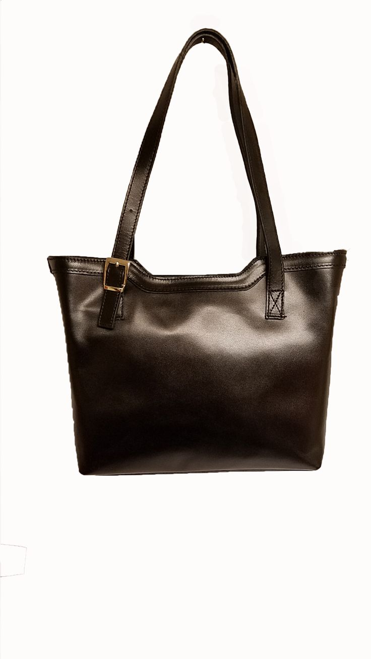Bag genuine cowhide leather External material: cowhide leather tanned. Inner Material: lining. Inside: 2 compartments, zip pocket, cell phone pocket. Outdoor: zip pocket behind. Accessories: nickel. Size - inches 11.09 x 9.45 x 4.53