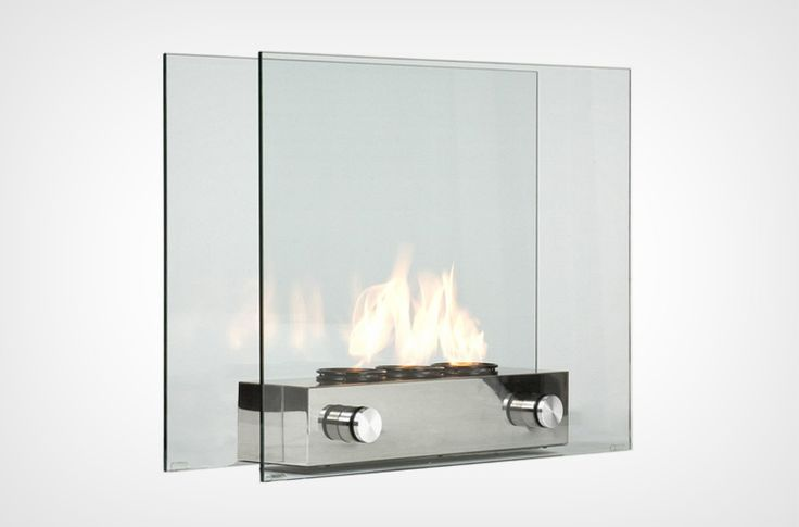 Portable Glass Fireplace. This fireplace is very modern with tempered glass and a brushed nickel base. Unique gift idea.
