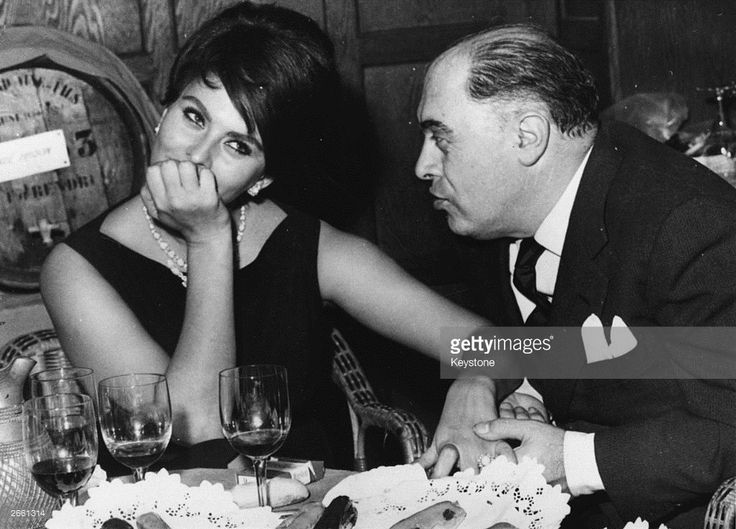 Italian film actress Sophia Loren in a restaurant in France with her husband Carlo Ponti, the man credited with discovering her.