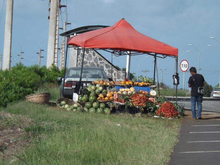 Fruit vendor on the side of the road in Mauritius.