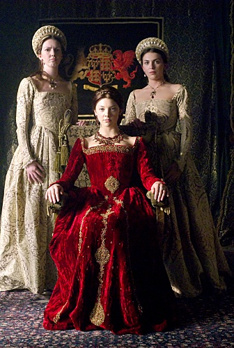 'The Tudors' mini-series (Natalie Dormer, dressed in red, as Anne Boleyn). Costume design by Joan Bergin.