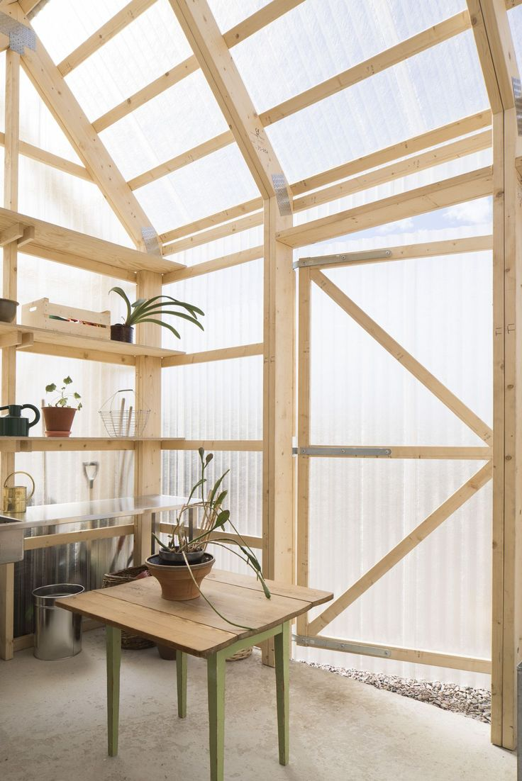A greenhouse with translucent corrugated polycarbonate walls and exposed wood frame in Forstberg Ling's House for Mother, Sweden