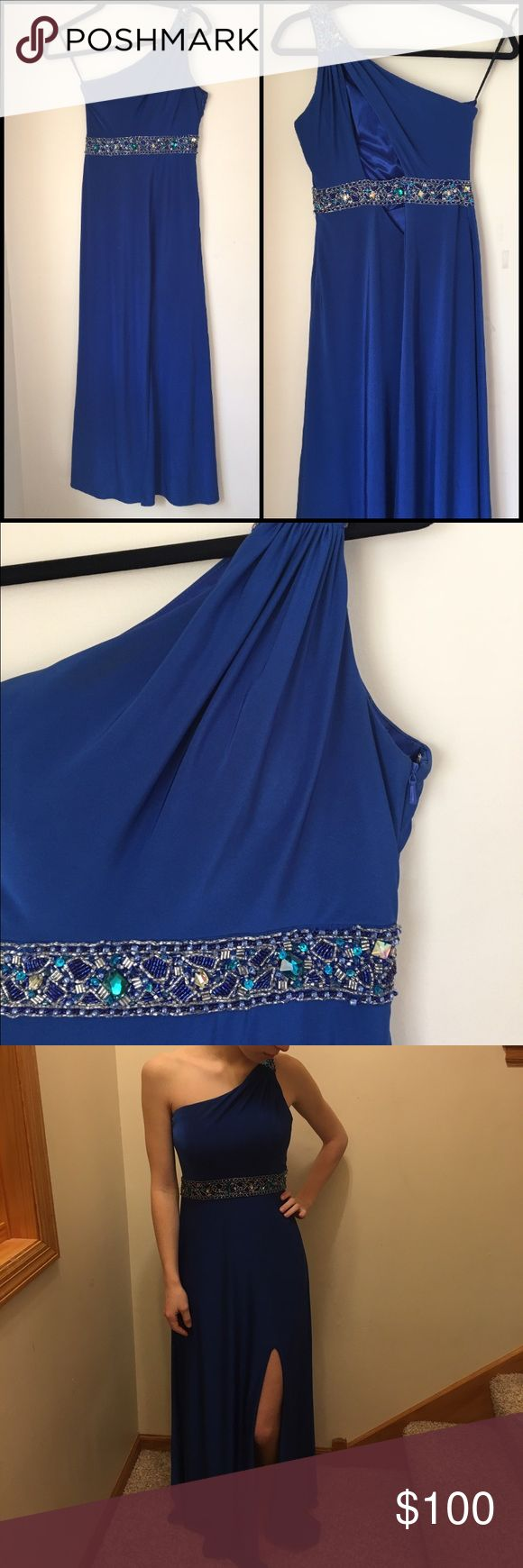 "Gigi Royal Blue, One-Strapped Prom, Pageant Dress This elegant, royal blue, one-strapped GiGi dress is in amazing condition! Only worn once - no stains, rips, or holes. Back of dress has a cutout. Jeweled belt along the waist. Left leg has an elegant slit. Zipper on the side of dress. Padded cups (not push-up, just substantially lined) so that you don't have to wear a bra. Note: the color in the last picture isn't accurate, just added that to model the dress. For reference, I'm 5'4"". Perfect…"
