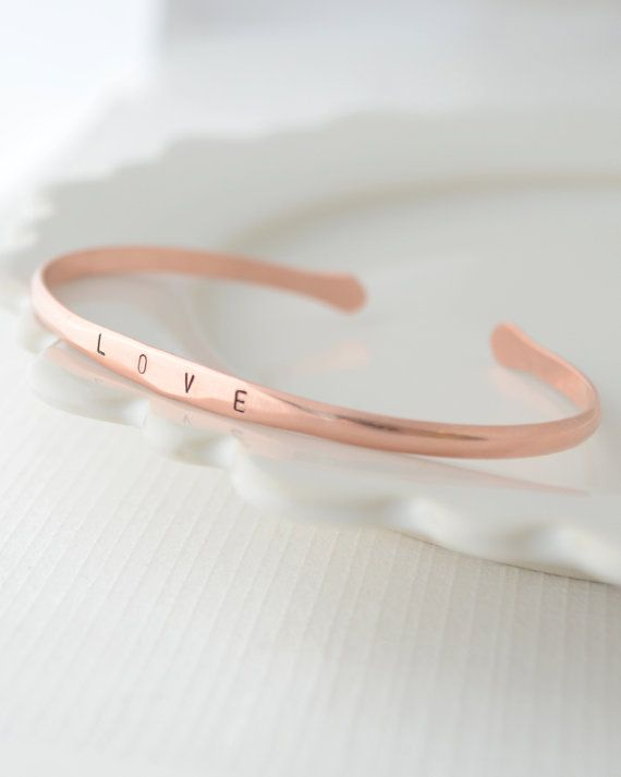 This adorable brass or copper handmade personalized bracelet can be hand stamped with up to 10 letters of your choice. Choose a name, date or word