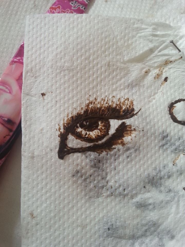 was soo bored so i thought just draw an eye with a hena/mehndi cone