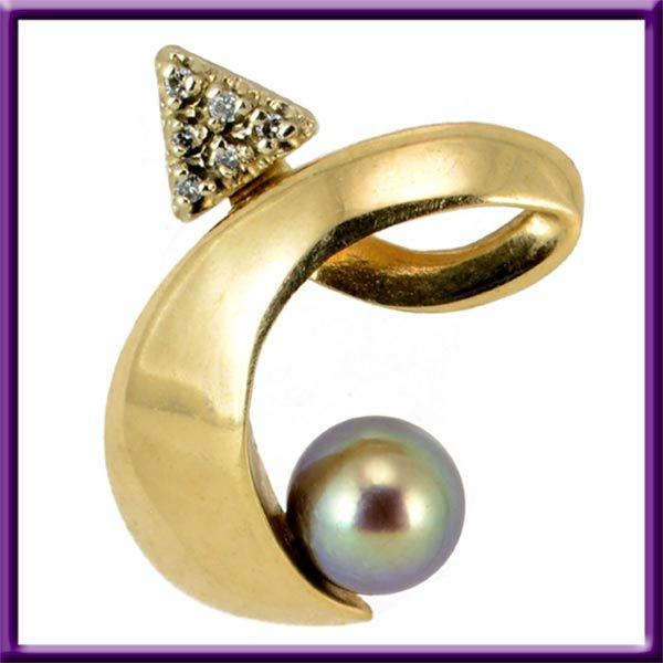 Vintage pendant 10K yellow gold black pearl and diamonds used. Pendant looks like a small cursive letter e or a Capital cursive letter C shape. For Sale $135.00