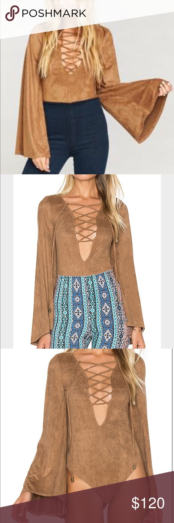 Show me your mumu Louisiana penny suede bodysuit New with tags. No offline transactions or trades. Reasonable offers via offer button only. Black also available.  Location: Boca Raton, FL. ***only listings coming from the same location can be bundled . REDUCED TO FINAL PRICE Show Me Your MuMu Tops