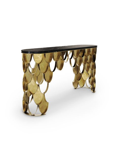 The KOI scales from the sides of the modern console table shine and reflect the sun on its brass surface. http://www.brabbu.com/en/casegoods/koi-console/