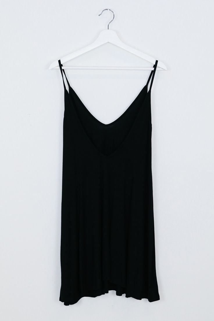 """• Soft and loose black tank dress • Available in s, m, l. aspyn is 5' 4"""" and wearing a size small • 95% rayon, 5% spandex"""