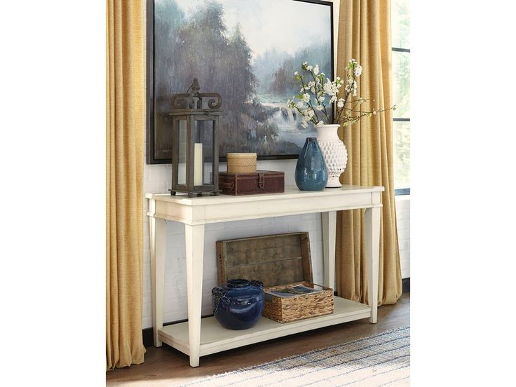 Shop for Trisha Yearwood Azaela Sofa Table, 919-826 STBL, and other Living Room Tables at Klaussner - Trisha Yearwood in Asheboro, NC. This off white painted finish features distressing with an aged texture to produce an authentic time worn appearance. This relaxed finish is a perfect complement for any home and offers a light accent to brighten any space.