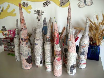 Love this - papier-mache garden gnomes, starting with small plastic bottles, newspaper, etc.  Can't wait to see when they are done.