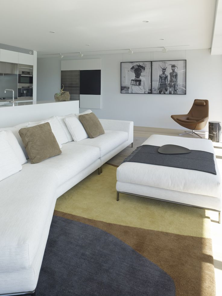 Living Space. Minotti sofa with Christopher Farr rug. Interior architecture by Johnson Pilton Walker. Interior furnishings by Brooke Aitken Design.