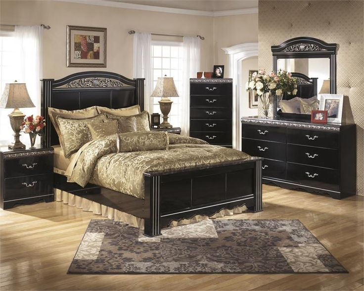 12PC Ashley's Bedroom Set by Signature Design from Ashley Furniture has a brown color over replicated burgundy. Curving friezes with deeply carved scroll motifs in a burgundy color tipping. Large scaled bail with rosettes in a dark brown color finish. $754.99