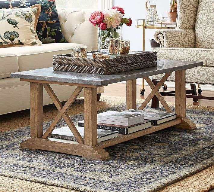 Rustic Coffee Table With A Marble Top That Has A Concrete Like
