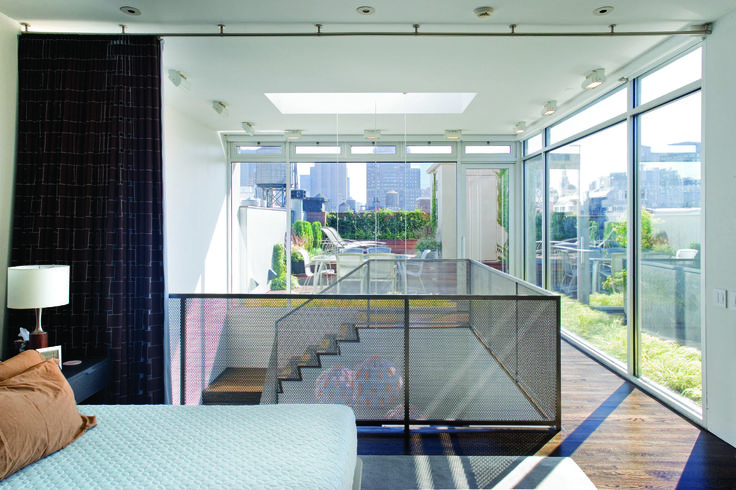 The glass enclosure combined with the use of textiles as architectural material creates a flexible space that is both transparent and private--a treasure in New York City. Not to mention the view!