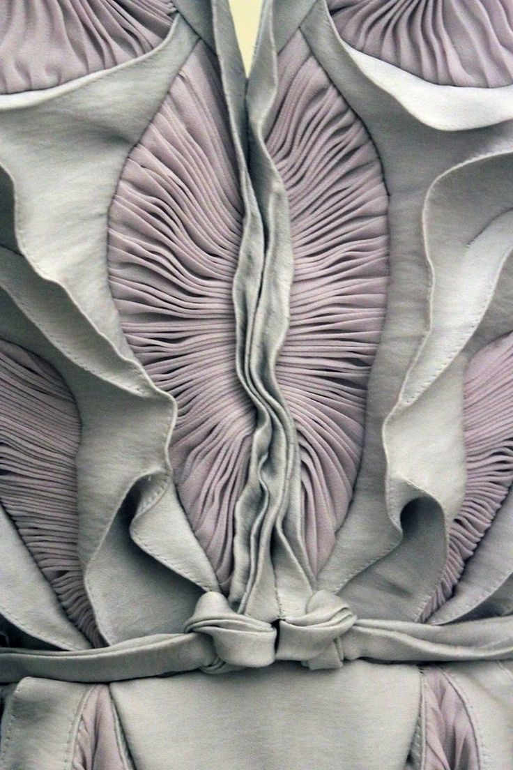 Amazing structures of layered pleats producing a textured garments resembling coral or magnified detail or organic structures like electron ...