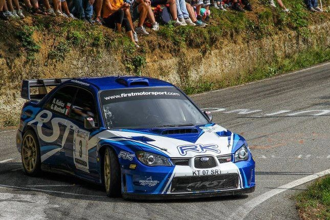 F1 driver robert kubica in a subaru subaru rally for Kubica cars