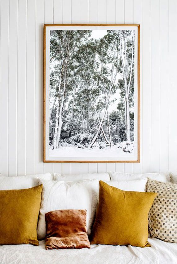 mustard yellow throw pillows on white sofa. / sfgirlbybay