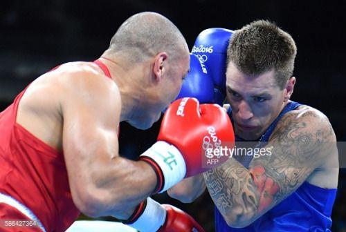Brazil's Juan Nogueira (L) fights Australia's Jason... #nogueira: Brazil's Juan Nogueira (L) fights Australia's Jason Eric… #nogueira