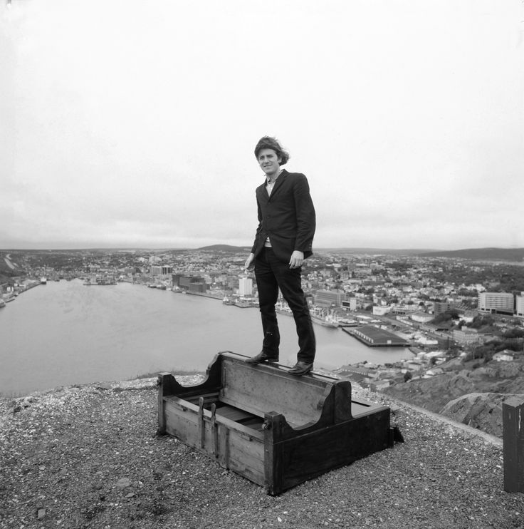 Gordon Monahan standing on piano, Gibbet's Hill, St. John's, NF, 1988. Photo by Thaddeus Holownia.