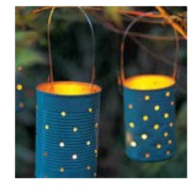 Soup cans painted and holes drilled in them - add a tea light and you're ready to light up your yard.