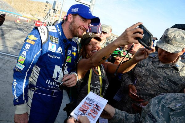 Dale Earnhardt Jr., driver of the #88s Nationwide Chevrolet, signs autographs following the Monster Energy NASCAR Cup Series Can-Am 500 at Phoenix International Raceway on November 12, 2017 in Avondale, Arizona.