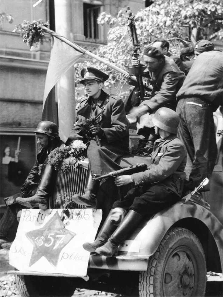 Czech Resistance fighters with captured German weapons and equipment parade through Prague during the Uprising. On 5 May 1945 Czech police officers burst into the radio station at Vinohradská Street and battled with the SS soldiers who were already occupying the building. The radio announcer, hearing the sounds of fighting, began to encourage the Czechs to rise against the Germans. Resistance fighters in other parts of the city took over the Gestapo and SiPo headquarters.