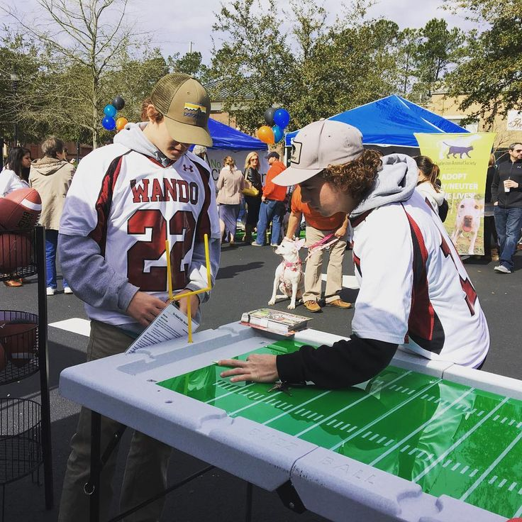 A couple of Wando High School students stopped by our tent at the @bellehallshoppingcenter Pup Bowl to play some #fingerfootball on the @buzz_ball Table! #wonderworkstoys  #magichappenshere #buzzball #football #superbowl #superbowl50 #charleston #charlestonsc #children #fun #games #hottoys #instatoys #kids #newtoy #play #pupbowl #toys #toystore #toystagram