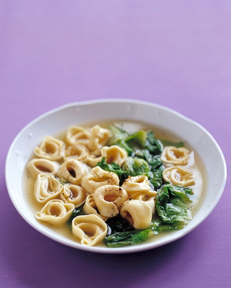 Tortellini in Broth with Escarole   Martha Stewart Living - This simple and satisfying dish is a quick version of a traditional Italian dish.