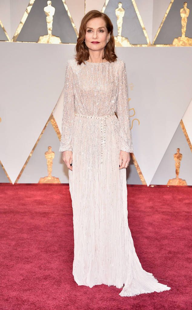 Isabelle Huppert from Oscars 2017: Best Dressed Women  The Elle actress' Armani Privé look is perfectly balanced by its feminine details (the shimmering beadwork, dainty belt, draped silhouette) and edgy add-ons (her dark lips and nails and envy-enducing ear cuff).