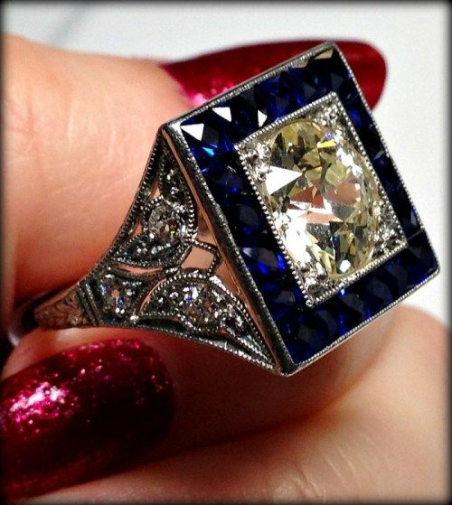 Antique Art Deco sapphire and diamond butterfly detail engagement ring at Chas Schwartz & Son. Via Diamonds in the Library.
