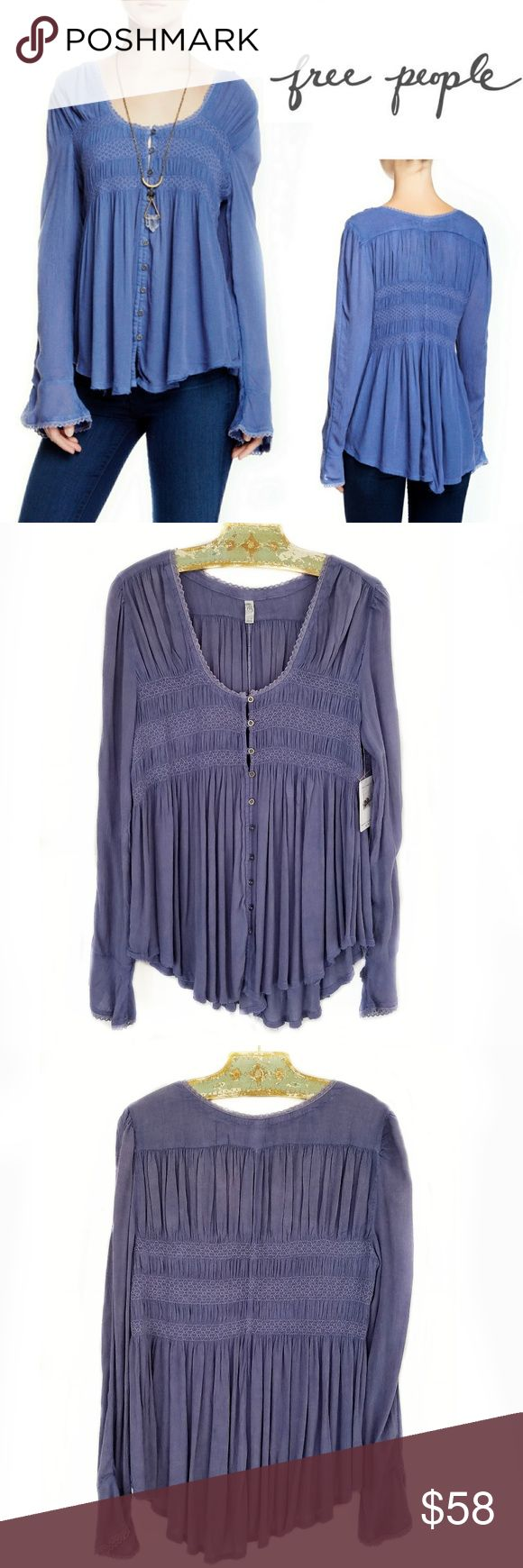 NWT Free People Bluebird Smocked Top Sz M NWT Free People Bluebird Smocked Top Sz M. Gauzy swing button down peasant top with smock detailing on the bust. Crochet trim, raw hem. Hand Wash. Excellent new unworn condition. Bundle and save! Sorry no trades. Free People Tops Tunics