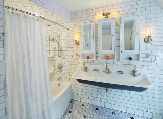 Cool idea for a kids bathroom - one oversized sink and three faucets. Individual medicine cabinets helps keep everyone's stuff separate