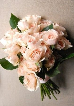 A simple clutch of blush spray roses. Lovely for bridesmaids.