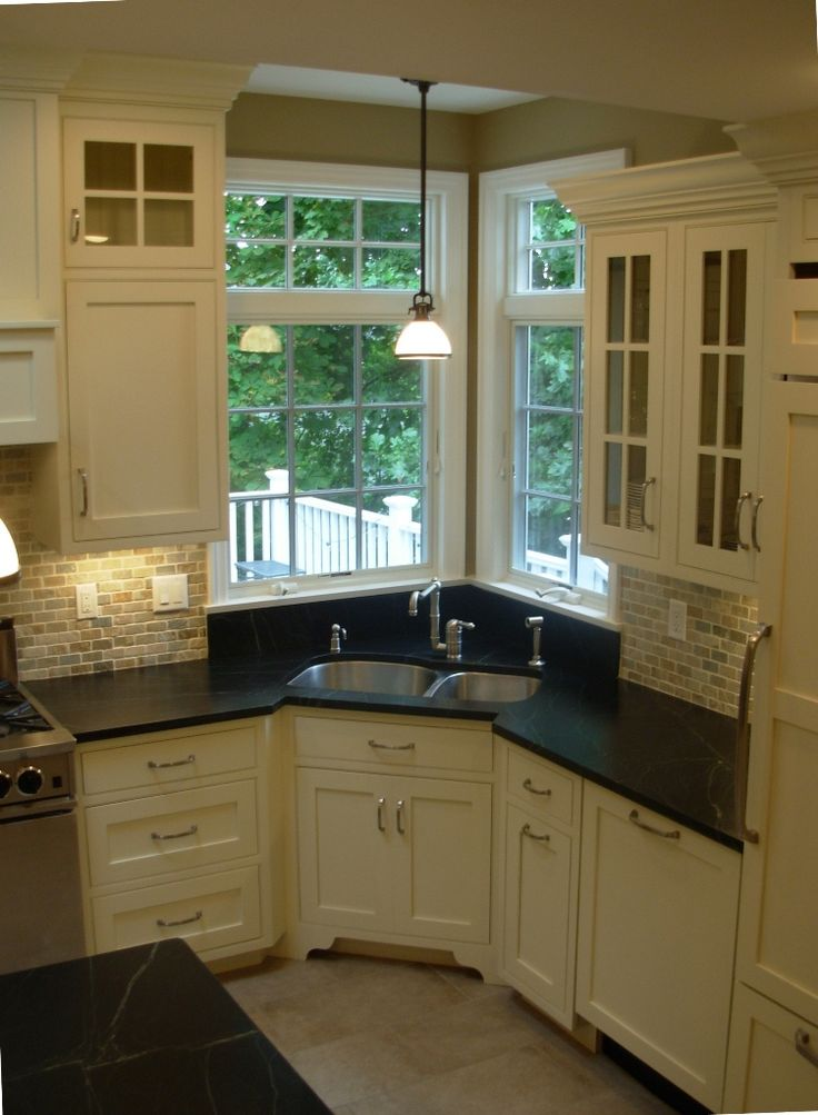 Corner sink sinks and corner kitchen sinks on pinterest for Kitchen door with window