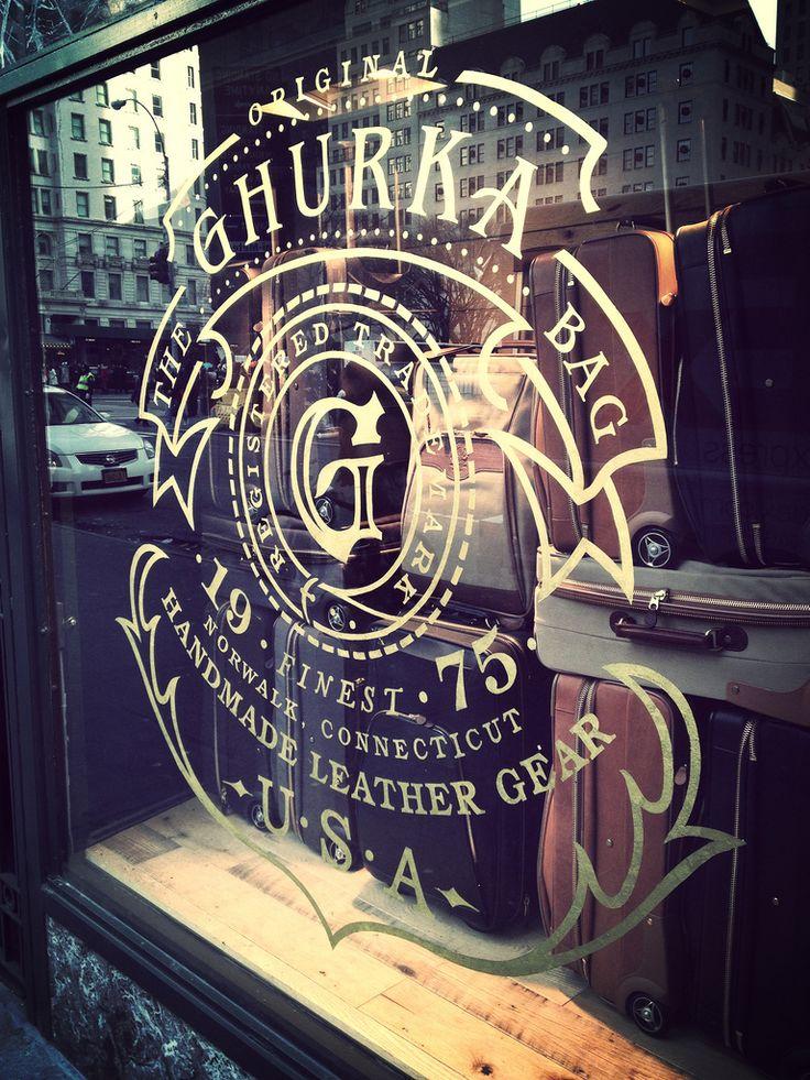 Creative guru signage on shop window window decals branding typography
