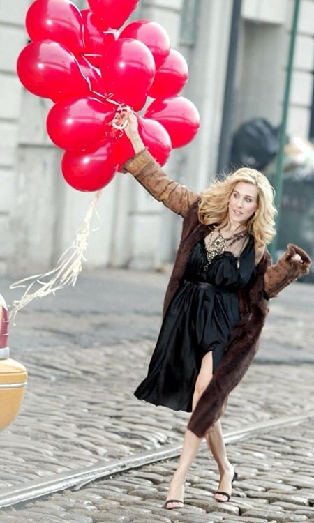 carrie bradshaw...you have to love the balloons, the hair, the black dress and those SHOES...God, you have to love those shoes!